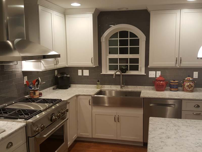 Kitchen remodel completed by LeFaivre Kitchen Contractors. Custom window, granite counters, gas stove.