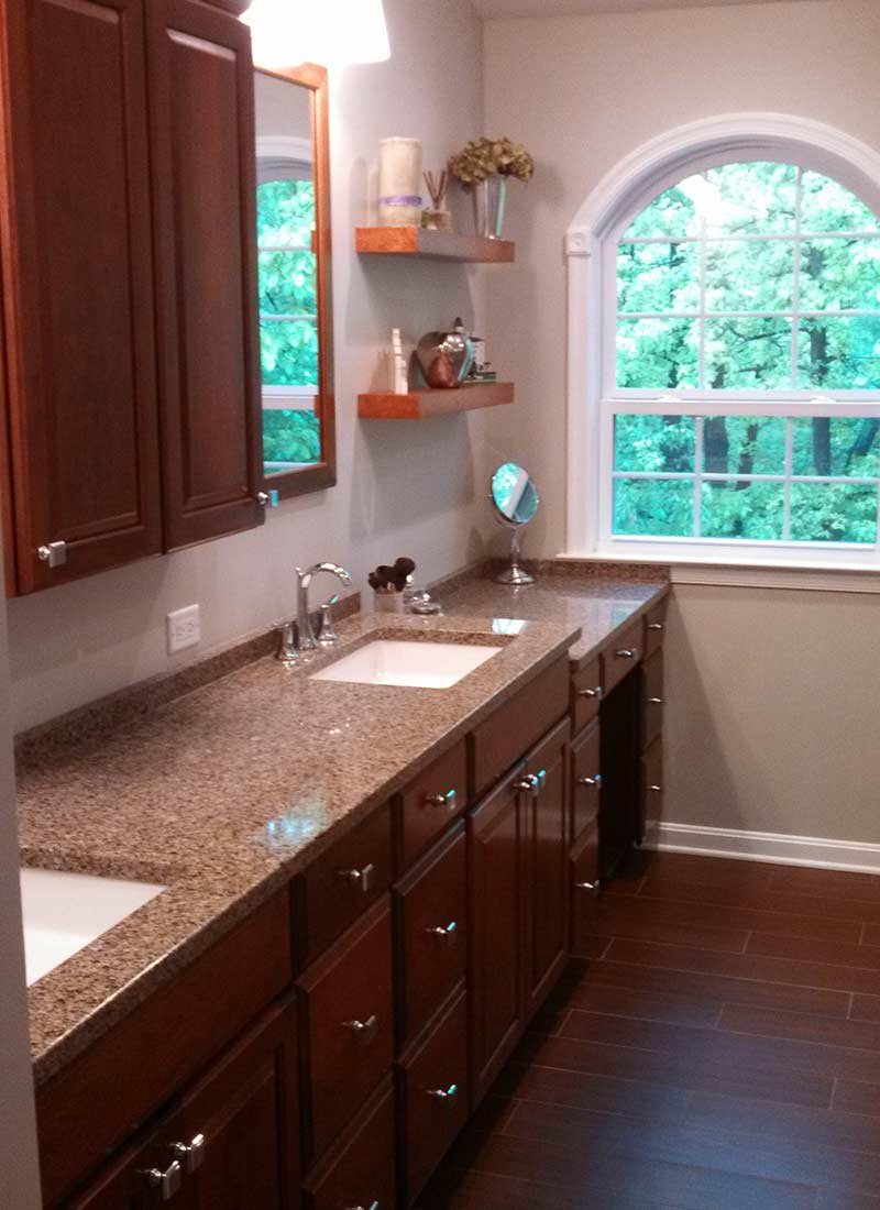 Bathroom remodel with granite countertop and a double sink vanity.